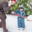 Woman and toddler boy having fun with snow — Stock Photo