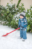 Adorable toddler boy happy about snow in winter — Stock Photo