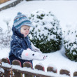 Little boy of one year having fun with snow — Стоковая фотография