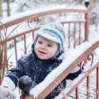 Royalty-Free Stock Photo: Little boy of one year having fun with snow