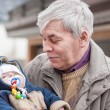 Grandfather and cute grandchild baby — Stock Photo #17627913