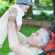 Grandfather and cute grandchild baby — Stock Photo #17628089