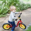 2 years old toddler riding on his first bike — Stock Photo #17651821