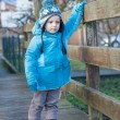 Cute toddler boy walking on wooden bridge — Stock Photo
