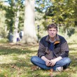 Young beautiful man in spring park — Stock Photo