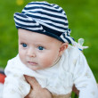 Cute little baby boy in summer garden — Stock Photo