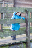 Cute toddler boy walking on wooden bridge — Stock Photo