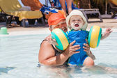 Grandmother and grandson swimming together in the pool — Stock Photo