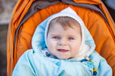 Little baby boy in warm winter clothes outdoor — Stock Photo