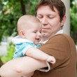 Little baby boy on father — Stock Photo