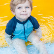 Toddler boy swimming, having fun and playing in water — Stock Photo