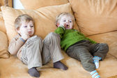 Two little brother boys watching tv indoor — Stock Photo