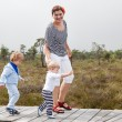 Young woman and two little toddler boys in nature park — Stock Photo