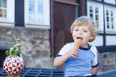 Little toddler boy eating ice cream in cone — Stock Photo