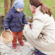 Stock Photo: Mother and little toddler boy on Easter Egg Hunt
