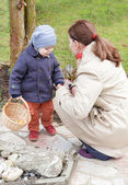 Mother and little toddler boy on Easter Egg Hunt — Stock Photo