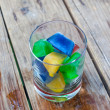 Colorful ice cubes in a glass — Stock Photo