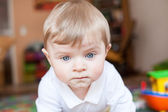 Portrait of adorable baby boy crawling — Stock Photo
