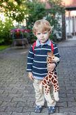 Adorable preschooler on way to school kindergarten summer — Stock Photo