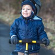 Royalty-Free Stock Photo: 2 years old toddler riding on his first bike