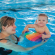 Little baby with blue eyes learning to swim - Foto de Stock