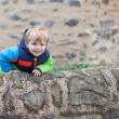 Little toddler boy having fun outdoors in German castle. — Stock Photo