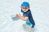 Little baby boy playing in the pool — Stock Photo