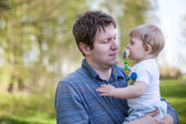 Young father and sweet baby boy in spring forest — Stock Photo