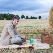 Young mmaking picnic on hay field — Stock Photo #21181323