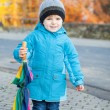 Beautiful toddler boy in blue clothes with umbrella — Стоковая фотография