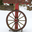 Decoration wheel during snowfall in winter garden — Stock Photo