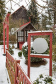 Japanese garden during snowfall in winter — Stock Photo