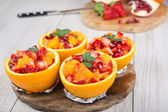 Fruit salad in hollowed-out orange — Stock Photo
