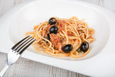 Spaghetti a la puttanesca with caper and olives — Stock Photo