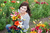 Young beautiful woman with lily bouquet — Stock Photo