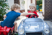 Two little brothers toddlers playing with cars — Stock Photo