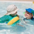 Two little toddlers playing in the pool — Stock Photo #22321323