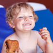 Adorable toddler boy with dirty chocolate face — Stock Photo