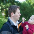 Young father and baby boy in spring forest - Foto Stock
