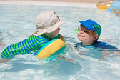 Two little toddlers playing in the pool — Stock Photo