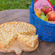 Fresh apple pie and fruits on wooden table — Stock Photo