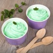 Frozen creamy ice yoghurt  with fresh peppermint — Stock Photo