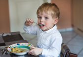 Little boy two years old eating pasta — Stock Photo