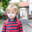 Little toddler boy on way to kindergarten - Stock Photo