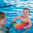Little baby with blue eyes learning to swim — Stock Photo