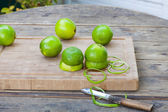 Fresh limes on wooden background — Stock Photo