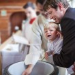 Stock Photo: Little baby boy being baptized