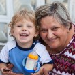 Grandmother with little toddler boy — Stock Photo #23825459
