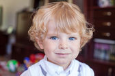 Portrait of blond toddler boy with curly hairs — Stock Photo
