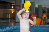 Toddler boy swimming, having fun and playing in water — Stock Photo